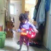 love when she strums her one string guitar, it actually sounds great