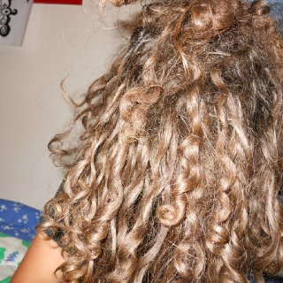 notice how curly my hair is where it's not knotted yet haha it's going WILD!