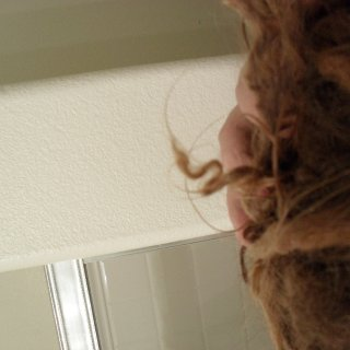 when your hair wants to blunt ends on it's own it goes from whispy to this then to a blunted end. I love this transitional phase, so fun. :)