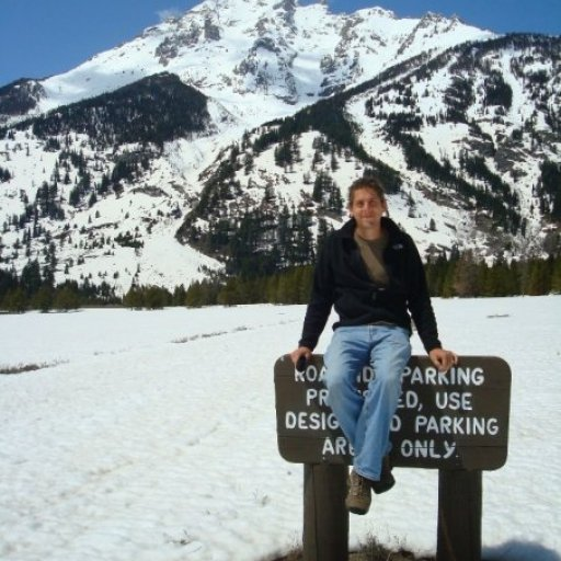 Tate sitting on sign in Grand Teton Mt ranage March 2009