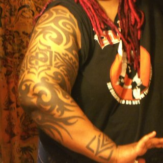 Dear Hannah Aitchison (Deluxe Tattoo Chicago -- long before her days on LA Ink) and Jacci Gresham (Aart Accent Tattoo in NOLA) did the sleeve and Yvette (Crescent City Tattoos in NOLA) did the wristcuff from my own design