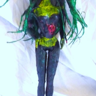 I found this old barbie doll with the fingers all chewed up and with slashes on the body. I decided to give her a makeover. Using papier mache and acrylic paints