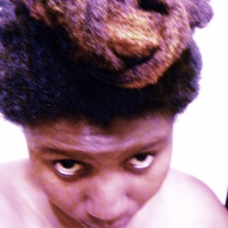 I was just playing around with my dreads to get them out of the way and this what I have.