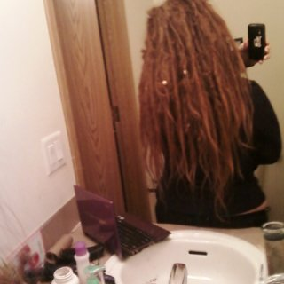 those long stragglers are my youngest dreads at about two months. i took apart a larger dread and made it into a few.