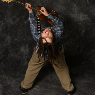 me and my custom SG guitar that i made photoshoot at college.