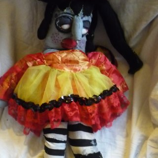 I love to make art dolls out of recycled fabrics and other materials and sometimes I paint the face and body when I am able to afford paint.
