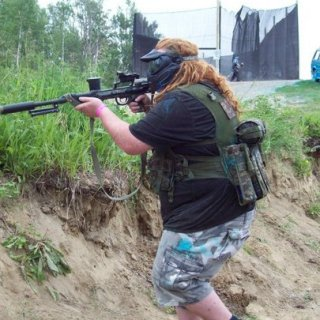 a picture of me paintballing in the 2010 season while using my 98 custom
