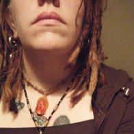 dreads + weirdo bling.