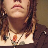 dreads + weirdo bling.