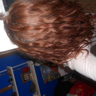 this is the side that is dreading alot better!!! you can see towards the top and back some nice dreadies are being born!